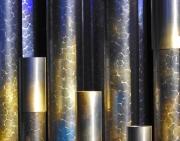 fleeting_sun_thru_church_window_onto_organ_pipes